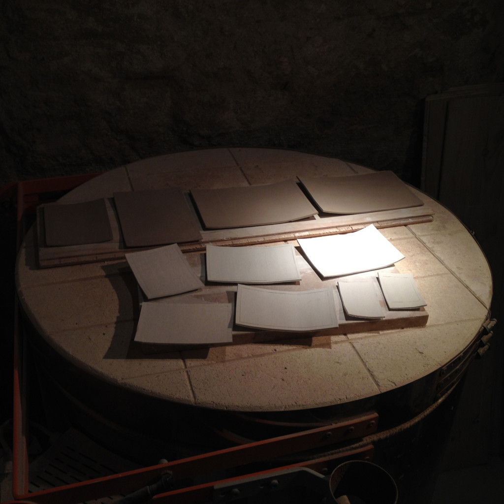 128a - Porcelaindrying (2014) - a series of porcelain plates drying on a kiln preparing for first firing at approx. 1200ºc